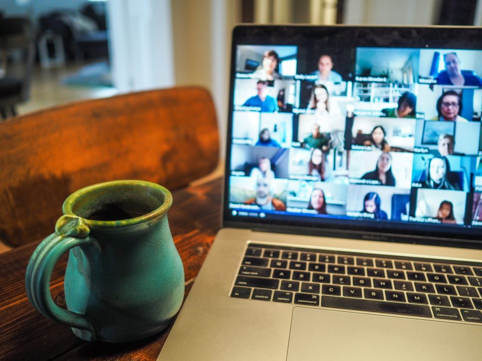Image of a Zoom call with a coffee cup.